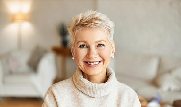 Freepik_close-up-image-of-happy-good-looking-elegant-fifty-year-old-woman-wearing-warm-cozy-jumper-pearl-earrings-and-short-stylish-hairdo-being-in-good-mood-sitting-in-living-room_karlyukav.jpg