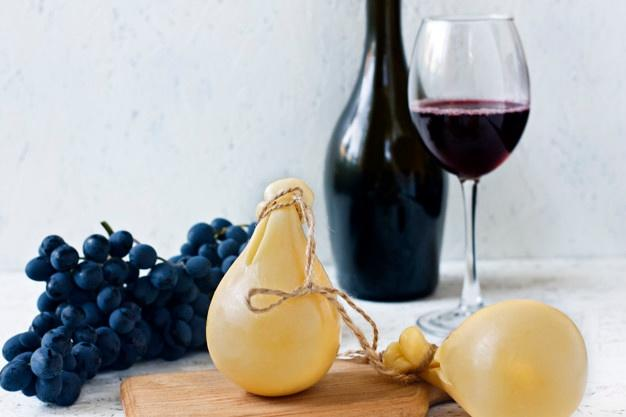 cheese-caciocavallo-glass-bottle-red-wine-grapes-cheese-pear_74197-264.jpg